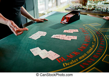 the dealer distributes chips in the casino