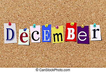 The december magazine cutout letters pinned to cork noticeboard