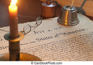 The Declaration of Independence with a burning candle,...