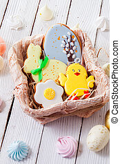 the delicious Easter gingerbread cookies on the wooden table