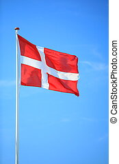 danish flag with blue sky on background
