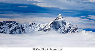 The Dent d'Hérens is a mountain in the Pennine Alps, lying...