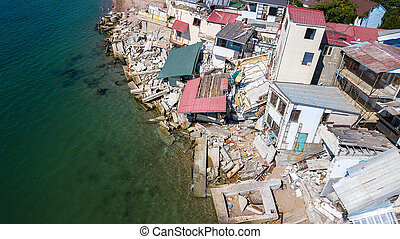 The destroyed house after the earthquake on the seashore