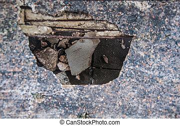 The destruction of a brick wall