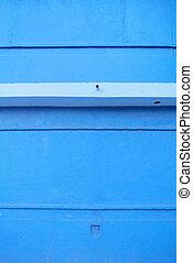 detail of bright blue facade