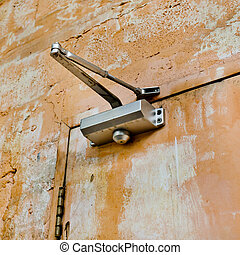 The device for automatic closing a door with old and rust door a