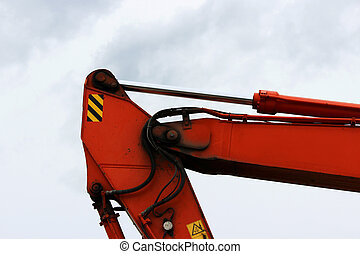 The device of a orange loader on the railway. Hydraulic system against the sky