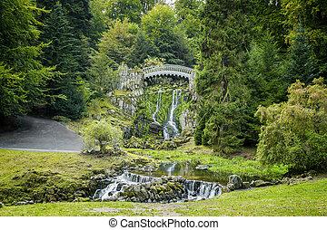 The devil bridge in the mountain park Wilhelmshoehe in...
