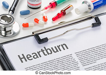 The diagnosis Heartburn written on a clipboard