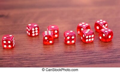 The dice lie on a wooden surface