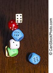 The dice roll on the wooden table. Role-playing game Dungeons and Dragons. Gambling in the casino.