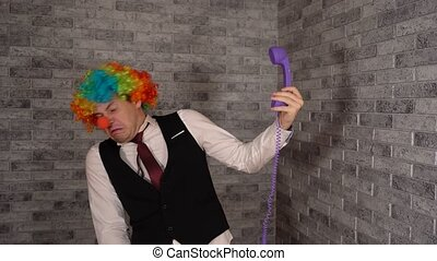 Office worker in clown wig, clown concept at work. Businessman with clown wig. Halloween