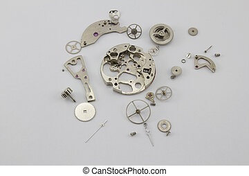 The disassembled mechanism - The sorted broken clockwork...