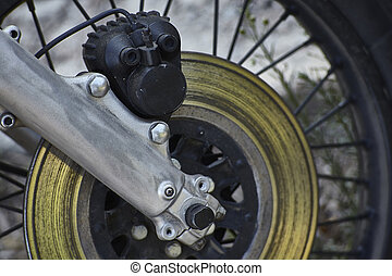 The disc brake of the vintage motorcycle.