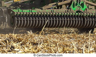 The disc harrow in the work. Soil cultivation after...