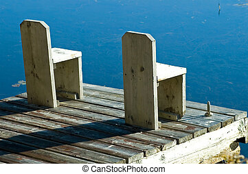 The Dock - A cottage dock on a lovely clear smooth lake,...