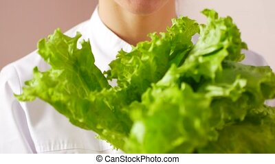 The doctor chooses between a salad or pills. Natural health concept.