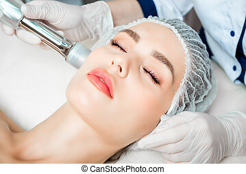 The doctor cosmetologist makes the Rejuvenating facial ...