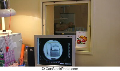 The doctor enables and configures the x-ray machine