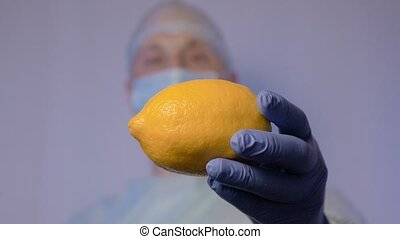 The doctor shows a lemon. This is a natural remedy for...