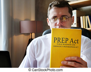 The doctor shows Public Readiness and Emergency Preparedness PREP Act book.