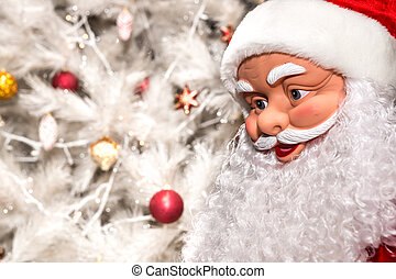 The doll in the form of Santa Claus on a white background Christmas tree with toys