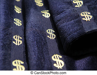The dollar sign embroidered on a fabric