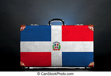 The Dominican Republic flag on a suitcase for travel.