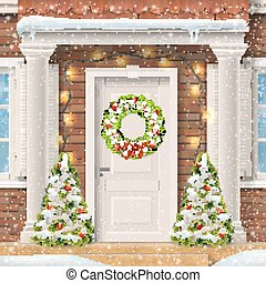 The door decorated with a Christmas wreath
