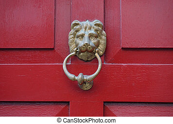 The door handle in the form of a lion