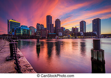 The downtown skyline at sunset, seen from Fort Point in Boston, Massachusetts.