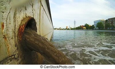 Waste water to city canal. Industrial pipe discharging...