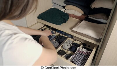 The drawer with underwear in the closet. Housewife...