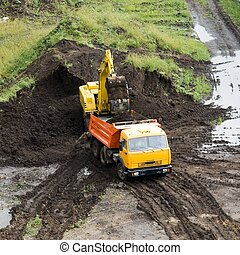 The dredge and the dumper truck