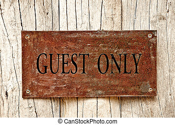 The Drilled text of guest only on iron sheet background -...