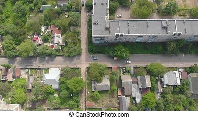 The drone surveillance aerial view city street cars private houses