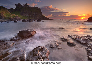 The Dunluce Castle in Northern Ireland at sunset