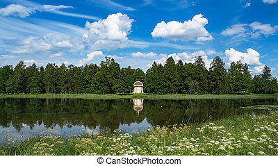 The eagle pavilion in the old Park of Gatchina. Summer minimalistic panoramic landscape with a lake in the Park.
