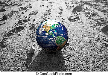 The Earth globe on rocky Mars like surface