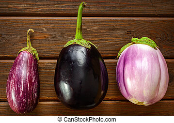 Eggplants Assortment On brown Wooden Background