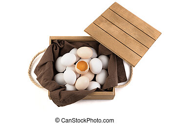 The eggs are white and brown with a broken egg in the center, in which a fresh yolk is visible.