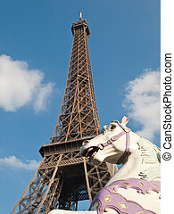 The Eiffel Tower and carrousel horse. Paris France