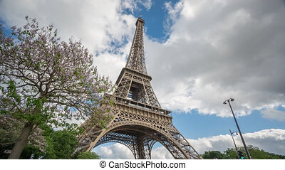 The Eiffel Tower in Paris time lapse from bottom