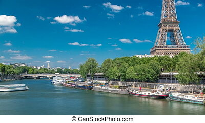The Eiffel tower timelapse from bridge over the river Seine...