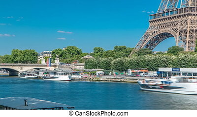 The Eiffel tower timelapse from embankment at the river...