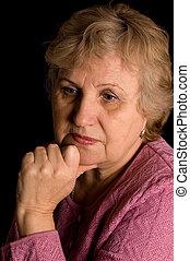 The elderly woman on black background