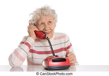 The elderly woman speaks on phone
