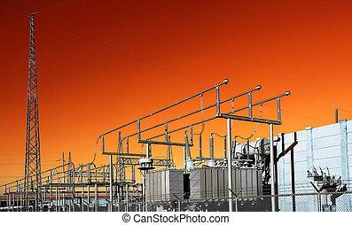Electrical Substation on the background of orange sky