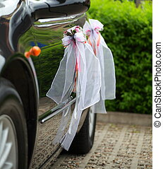 The elegant car for a wedding celebration