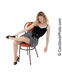 the elegant girl on a chair